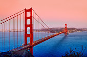 Golden gate bridge at sunset in dramatic sky, San Francisco, USA.