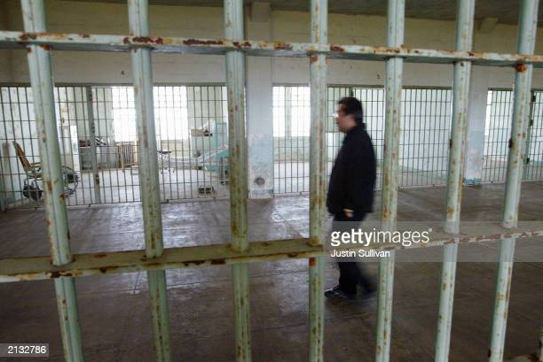 Golden Gate National Recreation Area worker Edwin Sera walks through the hospital of the Alcatraz Federal Penitentiary on Alcatraz Island July 2 2003...