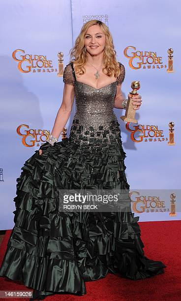 Golden Globe winner 1988 1995 2003 and 2012 Golden Globe nominee Madonna poses with the trophy at the 69th annual Golden Globe Awards at the Beverly...