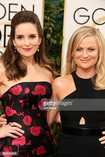 Golden Globes cohosts Tina Fey and Amy Poehler attend the 71st Annual Golden Globe Awards held at The Beverly Hilton Hotel on January 12 2014 in...
