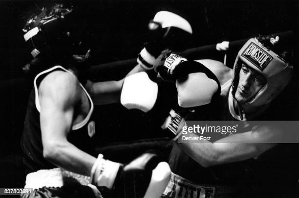 Golden Gloves Tony Williamson of Belfast blocks a Frankie Gonzales punch in the 112 1b match Friday night in the Auditorium Arena Credit The Denver...