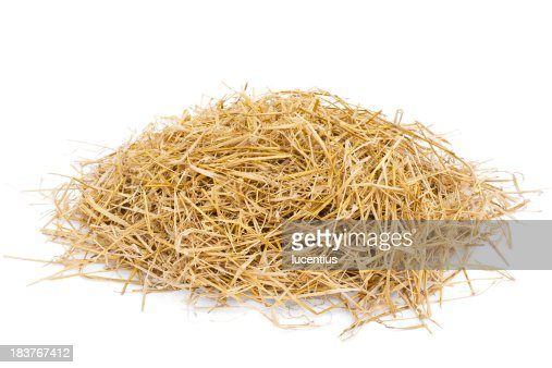 Golden hay heap isolated on white