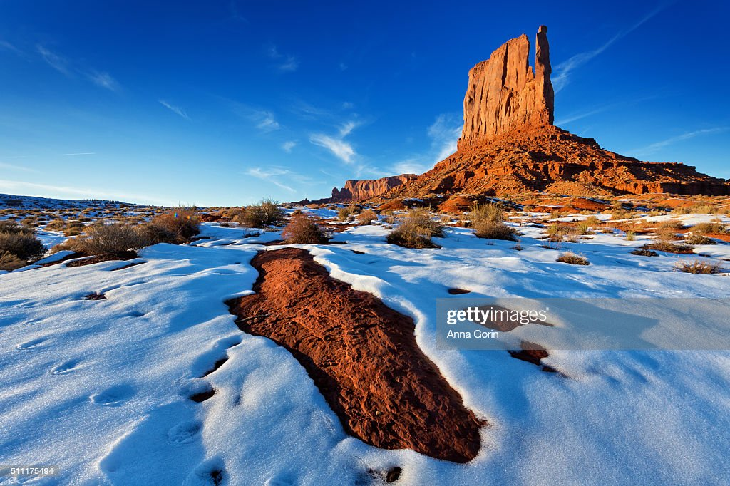 Golden hour on West Mitten in snow from Wildcat Trail in Monument Valley, Utah