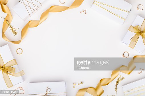 golden jewelry and gift boxes on white background with copy space for text. fashion and shopping concept. wedding, marriage or birthday composition. flat lay, top view : Stock Photo