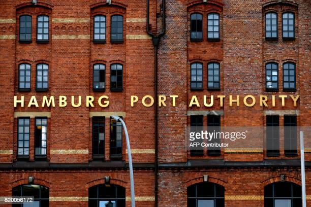 Golden letters on a former storage building of the Hamburg harbour are seen in Hamburg northern Germany on July 20 2017 / AFP PHOTO / PATRIK STOLLARZ