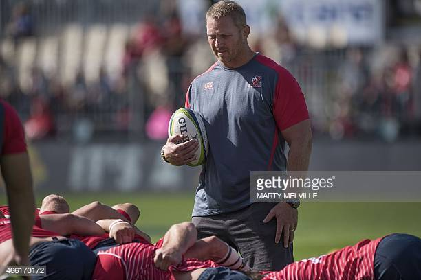 Golden Lions' head coach Johan Ackermann watches his team warm up ahead of the Super 15 Rugby Union match between the Canterbury Crusaders and the...