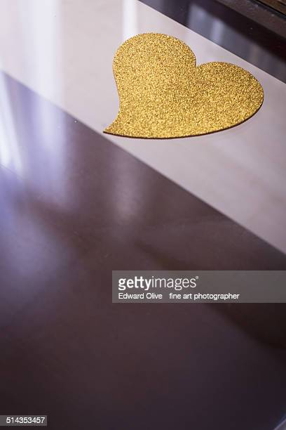Golden love heart on abstract background