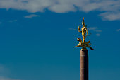 In the photo, in the rays of the setting sun, the main national symbol of Independence of the Republic of Kazakhstan is depicted - the stele of the Golden Man, in the form of a gold warrior with weapo