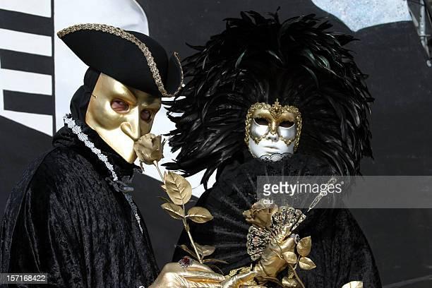 Golden mask venetian carnival black couple