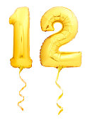 Golden number 12 twelve made of inflatable balloon with golden ribbon isolated on white background