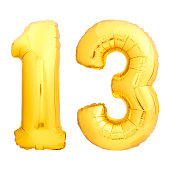 Golden number 13 thirteen made of inflatable balloon isolated on white background