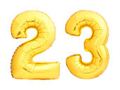 Golden number 23 twenty three made of inflatable balloon isolated on white background