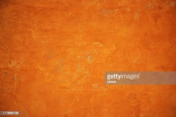 ゴールドのオレンジのグランジテクスチャ壁