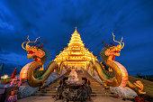 Golden Pagoda nine tier with dragon texture at Chinese temple - wat hyua pla kang , Chiang Rai,northern of Thailand