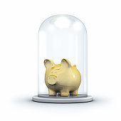 Golden Piggy bank under a Glass Jar