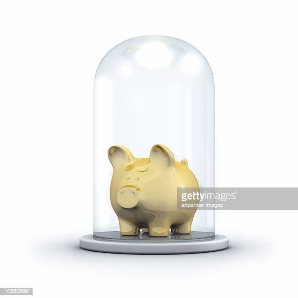 Golden Piggy bank under a Glass Jar
