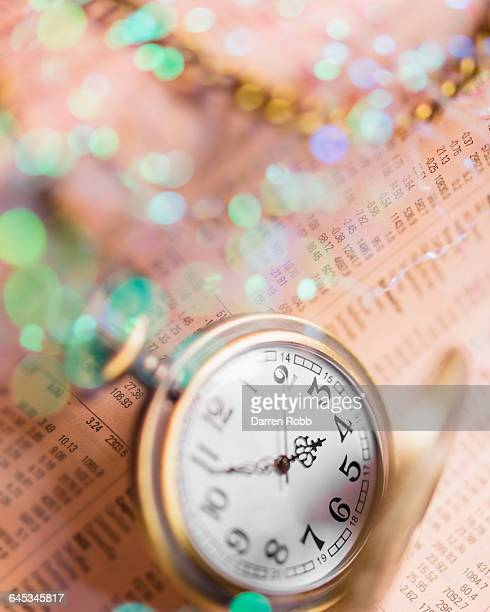 Golden Pocket Watch on Financial Newspaper