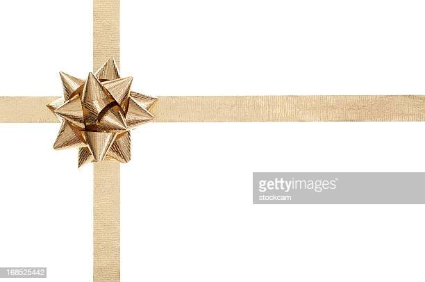Golden present bow and ribbon on white
