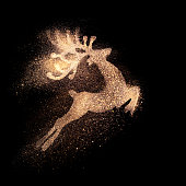 Flying reindeer made from golden glitter, photo compilation, selective focus.