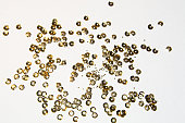 golden round sequins sewing on a white background