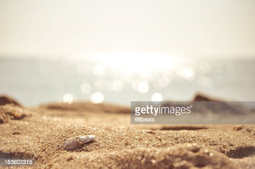 Golden sand with the sea on the background