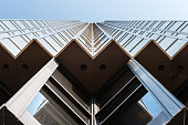 Low-angle view of a modern golden building in Toronto's financial district, Canada.