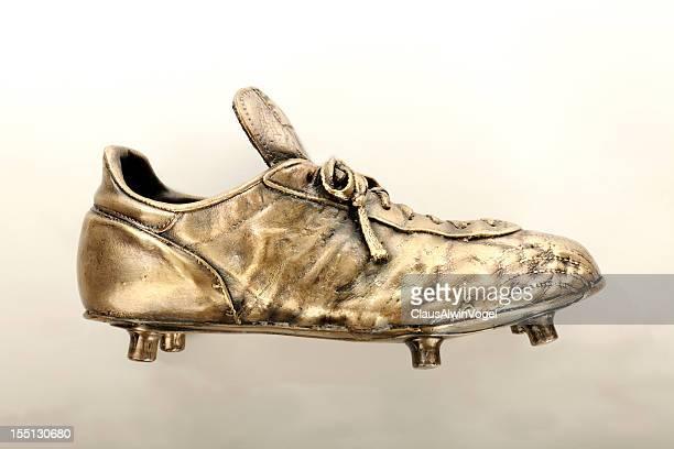Golden soccer shoe