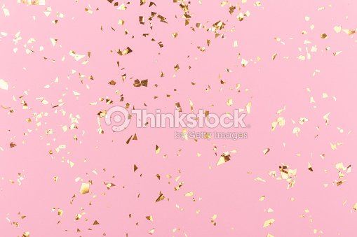 Golden sparkles on pink : Stock Photo