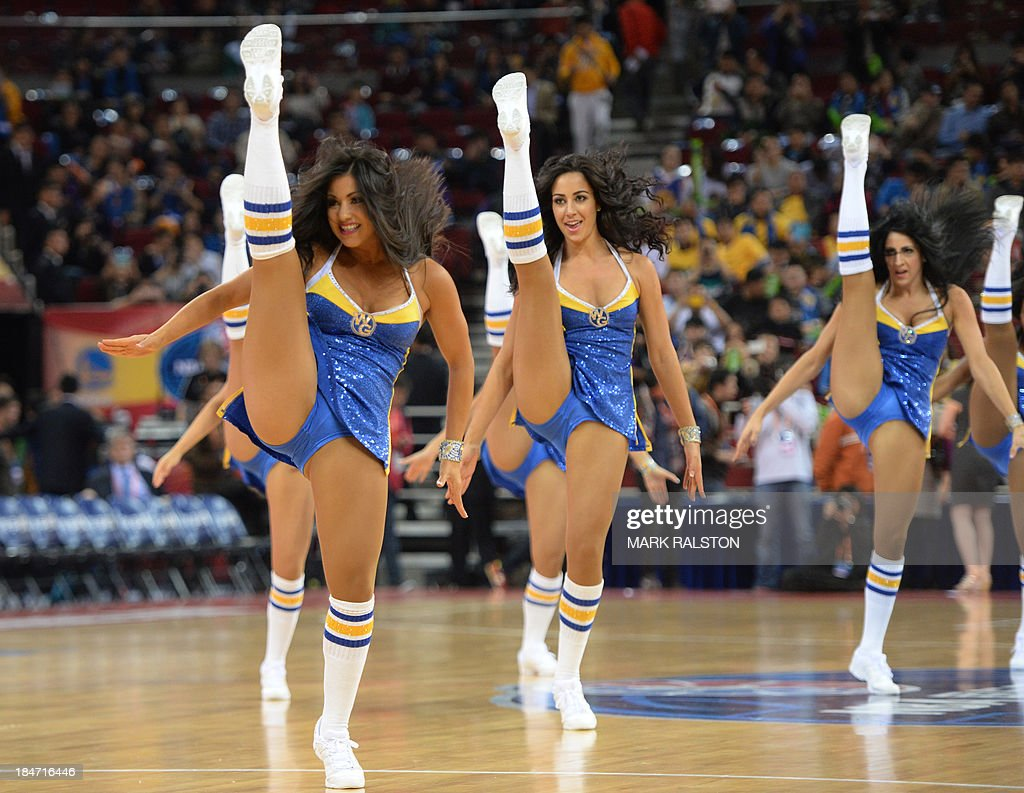 Golden State cheerleaders perform during the LA Lakers and Golden State Warriors NBA Global Game 2013 tour game at the Wukesong Stadium in Beijing on October 15, 2013. The Warriors went on to win 100-95. The NBA Global Games sees a total of 12 NBA teams playing in seven different countries around the world. AFP PHOTO /Mark RALSTON