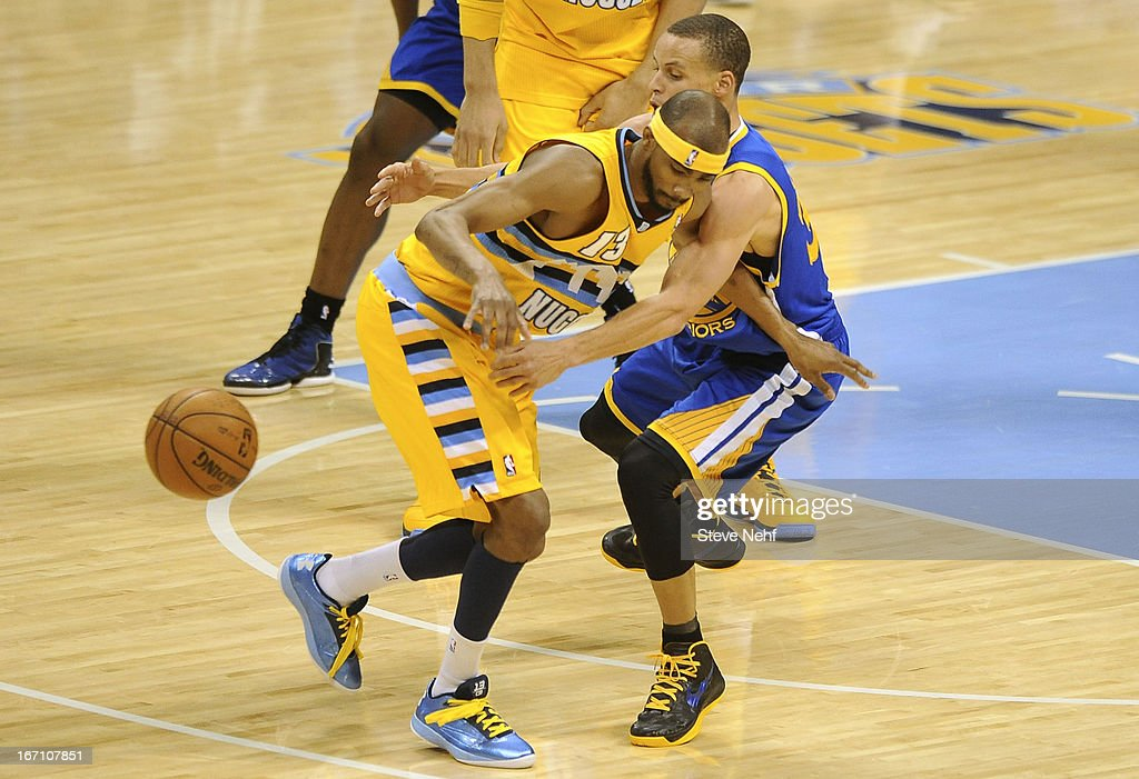 Golden State point guard Stephen Curry pokes the ball away from Corey Brewer of Denver in the fourth quarter. The Denver Nuggets defeated the Golden State Warriors 97-95 in Game 1 of the Western Conference First Round Series at the Pepsi Center in Denver, Colo. on April 20, 2013.