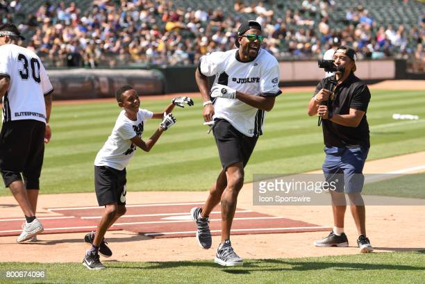 Golden State Warriors Andre Iguodala is greeted by his son Andre Tyler Iguodala II after a home run during JaVale McGees JUGLIFE charity softball...