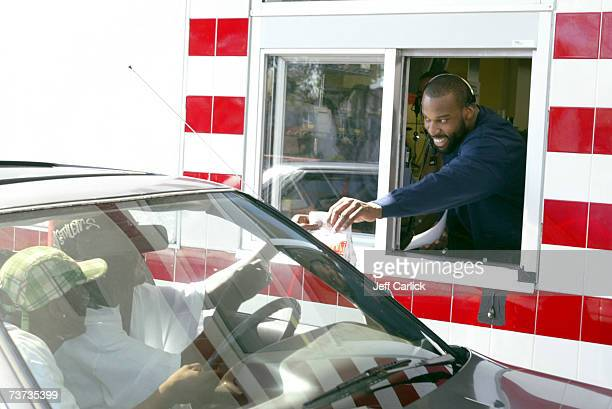 Golden State Warriors' Baron Davis gives away game tickets along with food order to fans at the drivethru window of McDonald's March 28 2007 in...
