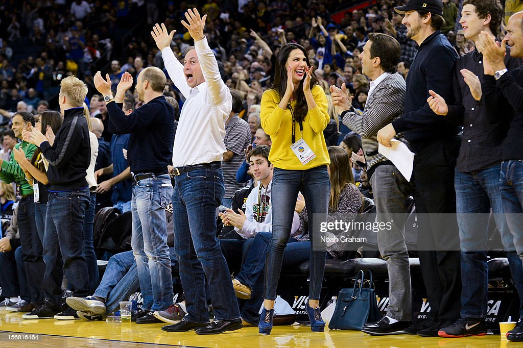 Golden State Warriors co-owners Joe Lacob, center left, and Peter Guber, center right, along with Lacob's fiancee Nicole Curran, cheer on the team during a game against the Brooklyn Nets at Oracle Arena on November 21, 2012 in Oakland, California.
