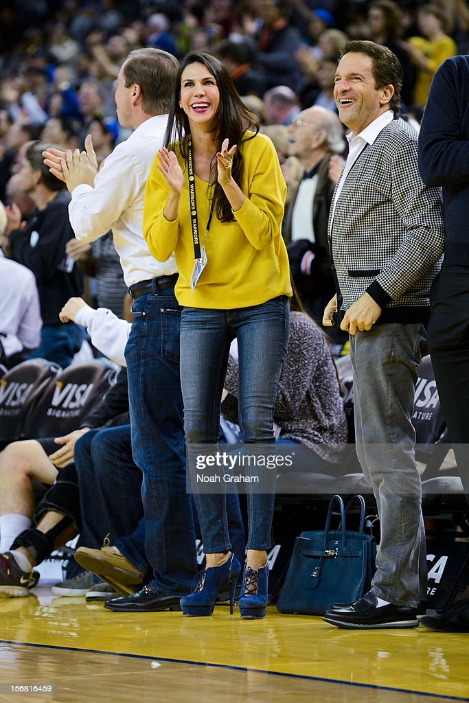 Golden State Warriors co-owners Joe Lacob, left, and Peter Guber, right, along with Lacob's fiancee Nicole Curran, cheer on the team during a game against the Brooklyn Nets at Oracle Arena on November 21, 2012 in Oakland, California.