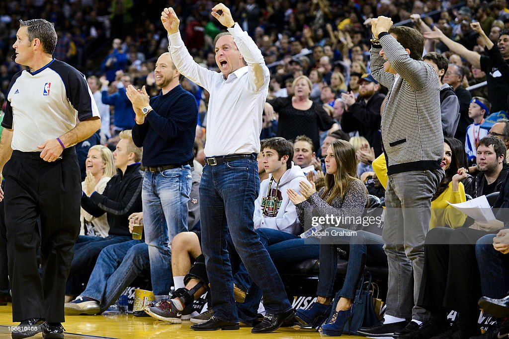 Golden State Warriors co-owners Joe Lacob, left, and Peter Guber, right, cheer on the team during a game against the Brooklyn Nets at Oracle Arena on November 21, 2012 in Oakland, California.