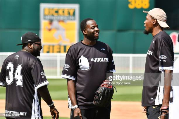 Golden State Warriors Draymond Green and Kevin Durant argue as Durant tried to replace Green at 1st base during JaVale McGees JUGLIFE charity...