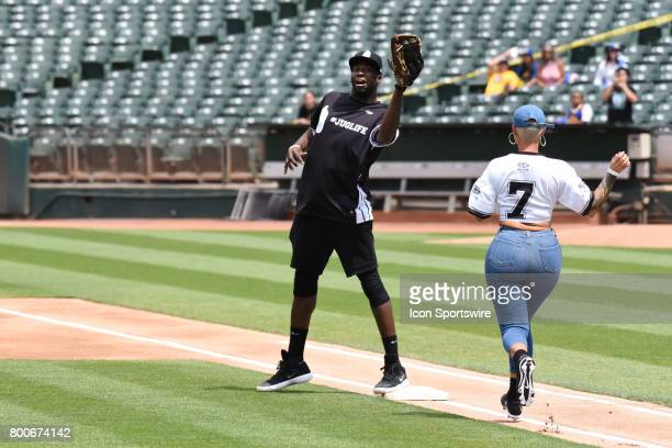 Golden State Warriors Draymond Green catches the ball as Actress Amber Rose runs up the line during JaVale McGees JUGLIFE charity softball game on...
