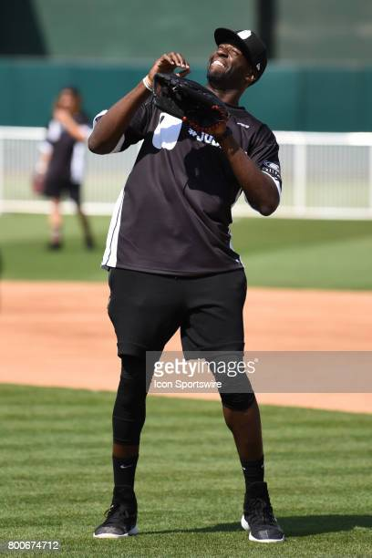 Golden State Warriors Draymond Green looks into the sun for a ball during JaVale McGees JUGLIFE charity softball game on June 24 at OaklandAlameda...