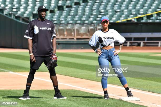 Golden State Warriors Draymond Green plays first base with Actress Amber Rose on first during JaVale McGees JUGLIFE charity softball game on June 24...