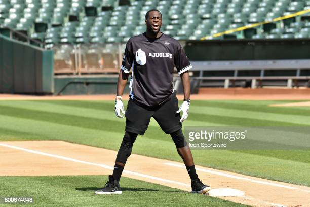 Golden State Warriors Draymond Green yells out instructions from first base during JaVale McGees JUGLIFE charity softball game on June 24 at...