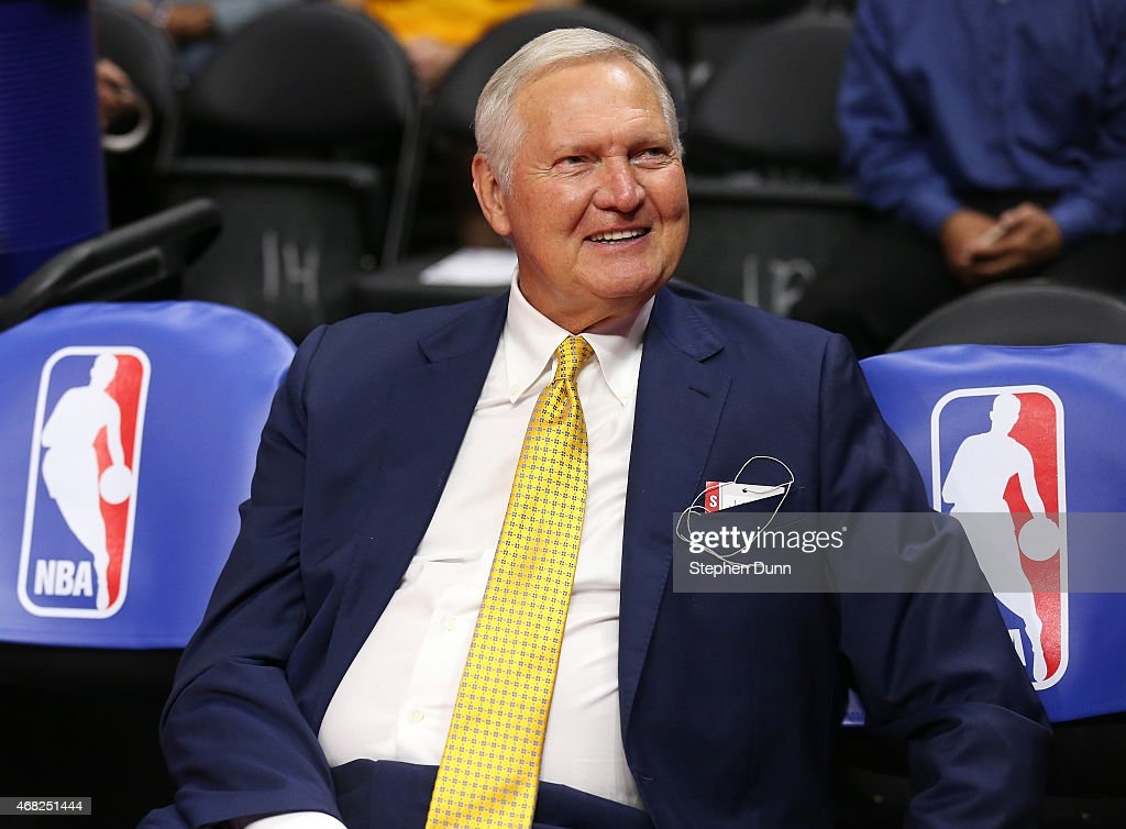 Golden State Warriors executive board member Jerry West sits on the bench by NBA logos before the game the Los Angeles Clippers at Staples Center on...