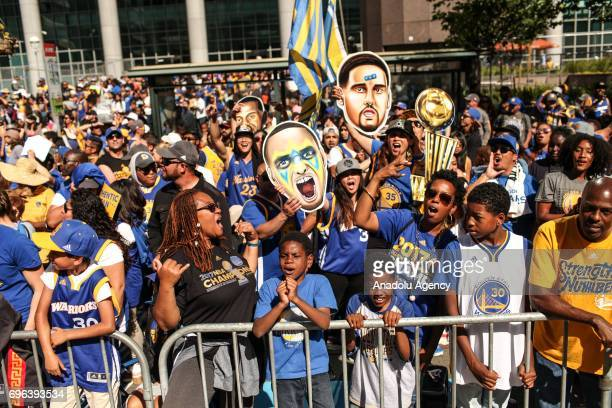 Golden State Warriors fans celebrate during the Golden State Warriors' NBA Championship parade and rally in Oakland CA USA on June 15 2017