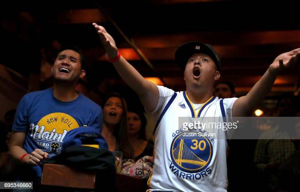 Golden State Warriors fans react as they watch game 5 of the NBA Finals between the Goldens State Warriors and the Cleveland Cavaliers during a watch...