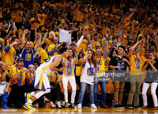 Golden State Warriors fans recat after Stephen Curry scored in the third quarter against the Houston Rockets during Game One of the Western...
