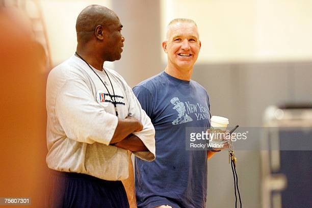 Golden State Warriors general manager Chris Mullin talks with NBDL head coach Larry Smith during practice on July 23 2007 at the Warriors Practice...