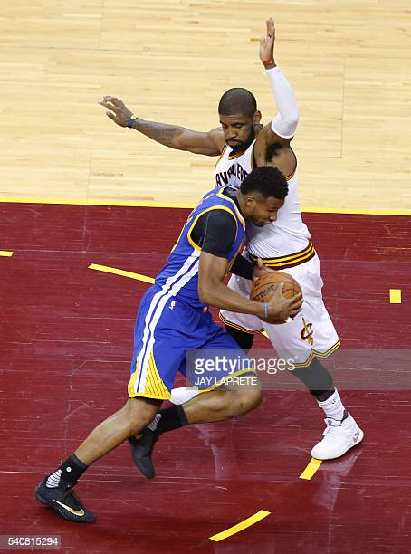 Golden State Warriors guard Leandro Barbosa drives against Cleveland Cavaliers guard Kyrie Irving during Game 6 of the NBA Finals in Cleveland Ohio...