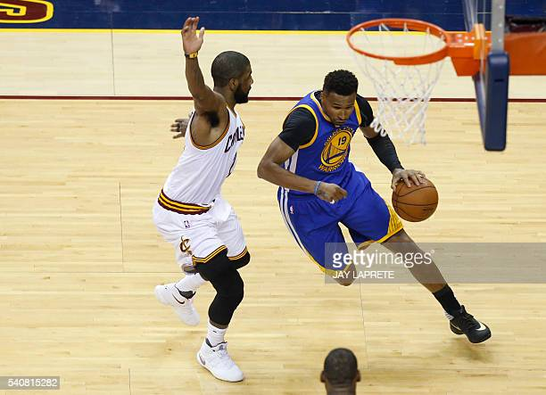 Golden State Warriors guard Leandro Barbosa drives to the basket against Cleveland Cavaliers guard Kyrie Irving during Game 6 of the NBA Finals in...