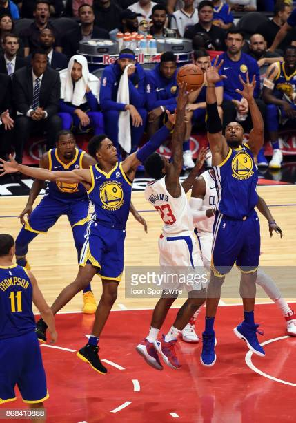 Golden State Warriors Guard Patrick McCaw and Golden State Warriors Forward David West block the lane against Los Angeles Clippers Guard Lou Williams...
