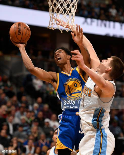Golden State Warriors guard Patrick McCaw goes up for a shot on Denver Nuggets forward Nikola Jokic during the third quarter February 13 2017 at...
