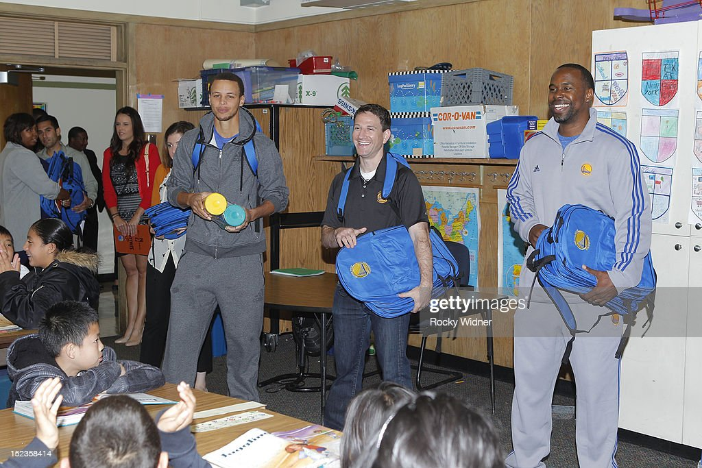 Golden State Warriors guard Stephen Curry and Assistant Coaches Darren Erman and Kris Weems visit students at Garfield Elementary on September 17, 2012 in Oakland, California.